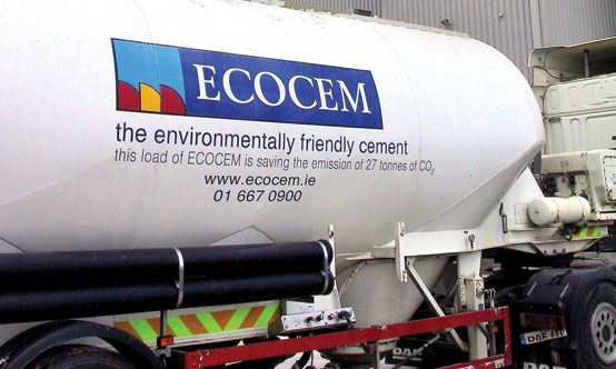 "Ecocem-branded delivery truck; the slogan reads ""this load of ECOCEM is saving the emissions of 27t of CO2."""
